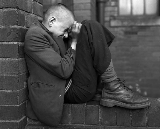 Chris Killip. Youth on Wall, Jarrow, Tyneside, 1976. Courtesy Museum Folkwang, Essen © Chris Killip